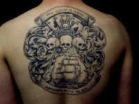 Pirate flag with cards and skulls and ship tattoo