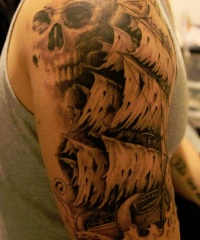 Pirate ship and skull tattoo