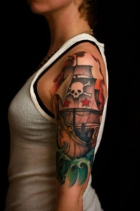 Pirate ship tattoo on arm